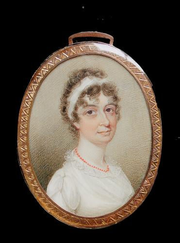 A portrait miniature of a young girl
