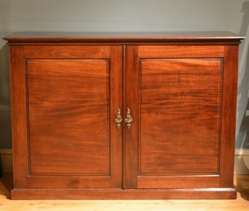 A George III mahogany low two door side cabinet ​Circa 1775