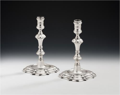 A very rare pair of George II Cast Tapersticks made in London in 1745 by James Gould