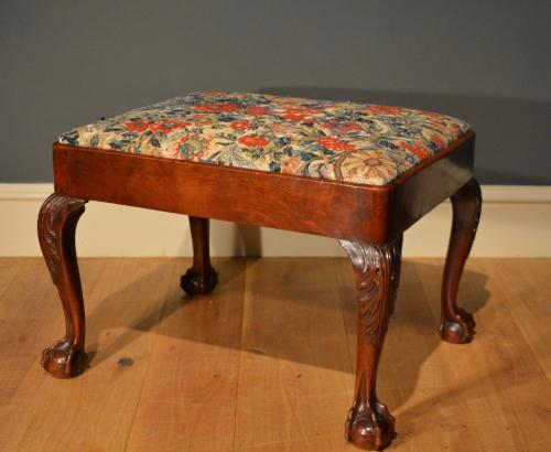 A large George II cherry wood stool