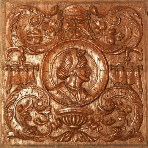 An 'antiquarian', Romayne, carved, oak panel