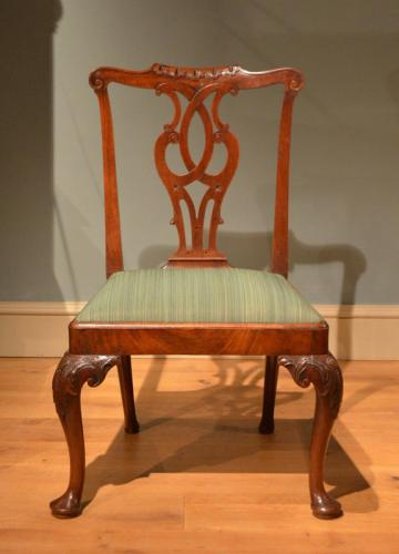 A carved mahogany cabriole leg side chair