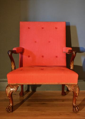 A carved mahogany parcel gilt Gainsborough chair