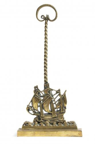A 19th century brass ship doorstop, in the form of the Mayflower