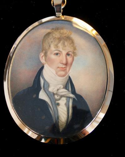 A portrait miniature of a Gentleman in blue coat