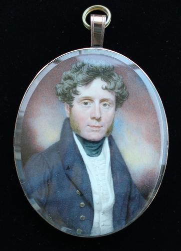 A portrait miniature of a Gentleman with initials HC, wearing slate grey coat