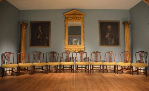 A fine set of George III mahogany dining chairs comprised of 2 armchairs and 8 single chairs.