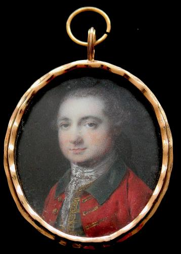 A Georgian portrait miniature of a gentleman wearing red coat with green collar