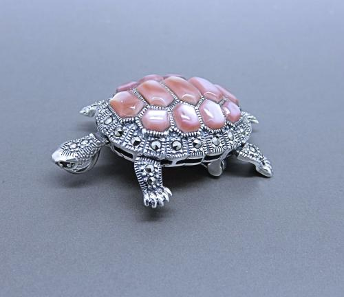 A Marcasite and Pink Mother of Pearl Brooch