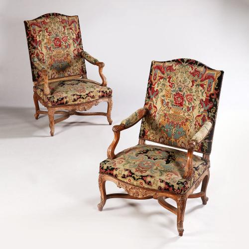 A Fine Pair of Early 19th Century French Walnut Fauteuils