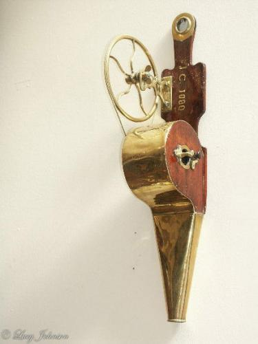 A fine, pair of mahogany and brass, mechanical bellows