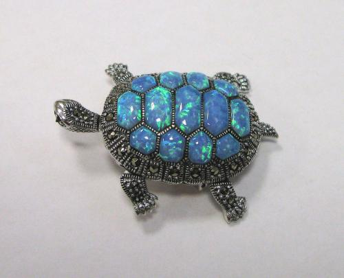 A Marcasite and Blue Opal Brooch