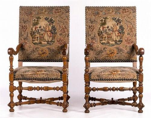 A pair of antiquarian, Louis XIII inspired, walnut open armchairs