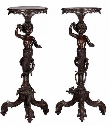A pair of antiquarian, Italian, Rococo inspired torcheres
