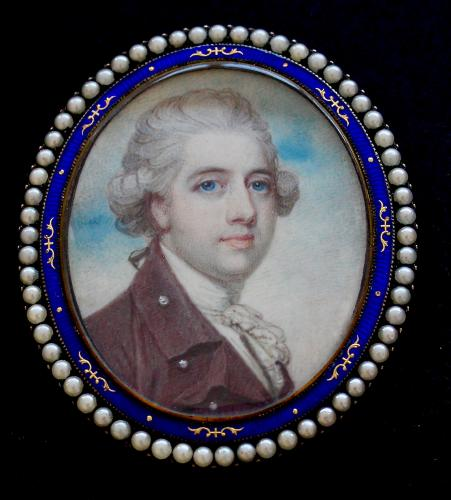 An 18th century portrait miniature of a gentleman wearing a plum coloured coat with pearl button