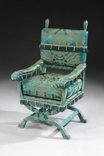 A 19th century ' X ' chair, re-upholstered in a green, silk damask