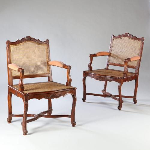 A Pair of Walnut Caned Bergeres