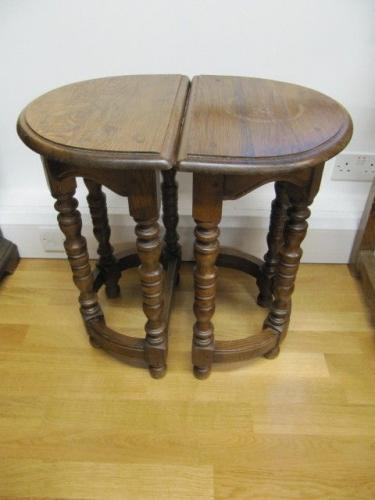 A pair of 20th century, oak stools
