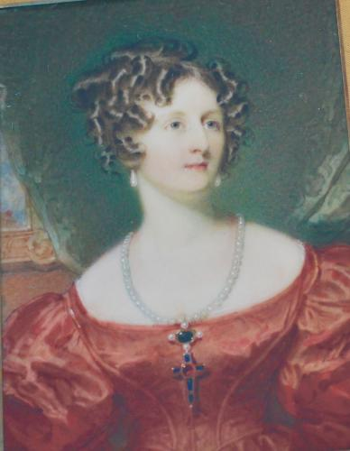 A portrait miniature of a Lady in red dress