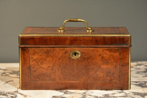 An early 18th Century walnut brass mounted tea caddy