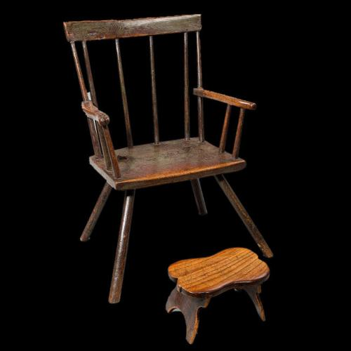 Primitive Welsh child's armchair with a separate little Elm Foot Stool, circa 1800 – 1820.