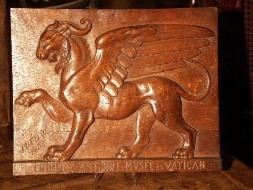 An 'antiquarian' carved, oak panel with the inscription ' CHIMERE ANTIQVE.MVSEE DV Vatican ' J Denys 1908