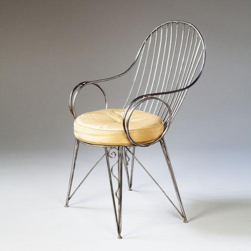 A Polished Steel Desk Chair