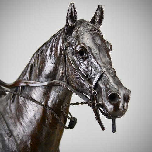 Detail of Sydney March equestrian bronze group.