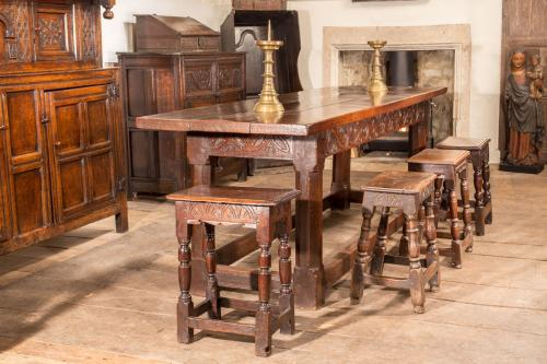 Refectory table with joint stools