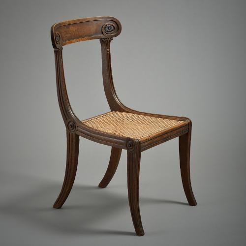A Regency oak and ebonised chair with caned seat, circa 1810.