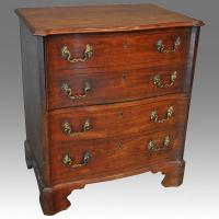 Small serpentine commode chest
