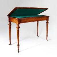 A mid 19th century burr walnut card table