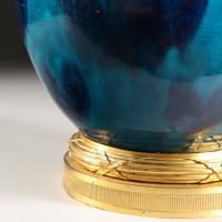 A VARIEGATED BLUE GLAZE VASE AS A LAMP