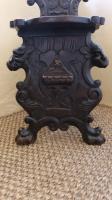 Pair of mid 17th century oak scabelli chairs with scroll work leaf detail and paw feet