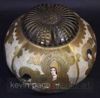 A Japanese satsuma koro with a metal lid